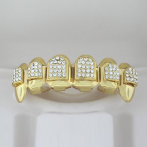 Ninety-Four points of ice Dracula style golden playa grillz