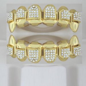 Ninety-Four points of ice Dracula style golden playa grillz top and bottom combo