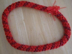 Hawaiian crochet lei rosette w/ red satin rattail cord