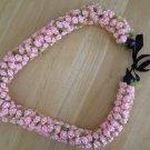 Hawaiian crochet lei rosette w/ pink satin rattail cord green eyelash