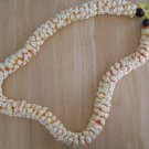 Hawaiian crochet lei rosette w/ ivory satin rattail cord orange eyelash yarn