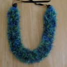 Hawaiian knit lei w/ multi-color blue green yellow eyelash yarn