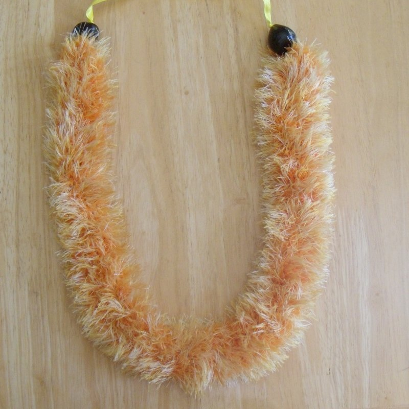 Hawaiian lei hat band knit w/ multi-color orange yellow eyelash yarn