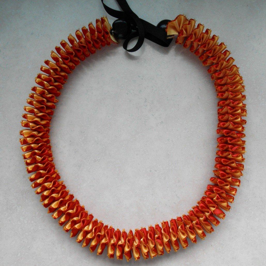 Hawaiian lei w/ red yellow satin ribbon