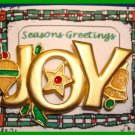 Christmas PIN #062 JOY Signed GCI Goldtone with Orn, Star & Bell w/Green Holly