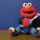 Sesame Street Rock and Roll Tickle Me Elmo Animatronic Electronic Singing Doll