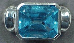 BLUE TOPAZ EMERALD CUT RING
