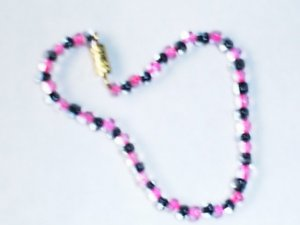 "1 dozen assorted 6"" glass beaded bracelets"