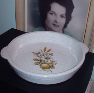 A Pie Plate made by Blue Mountain Pottery Country Charm Pattern