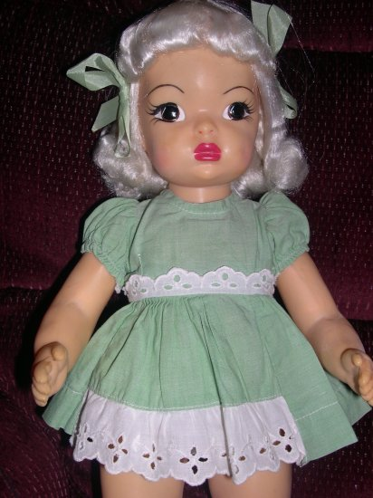 "Terri Lee 16"" Platinum 1950's hard plastic doll in green tagged dress"