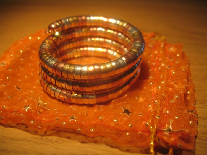 Tri-color (gold/silver/copper) spiral coil bangle
