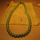 String of dark green faux pearls