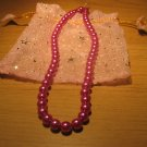 String of Fuschia pink faux pearls
