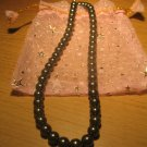 String of dark gray faux pearls
