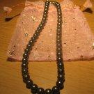 String of dark gray faux pearls