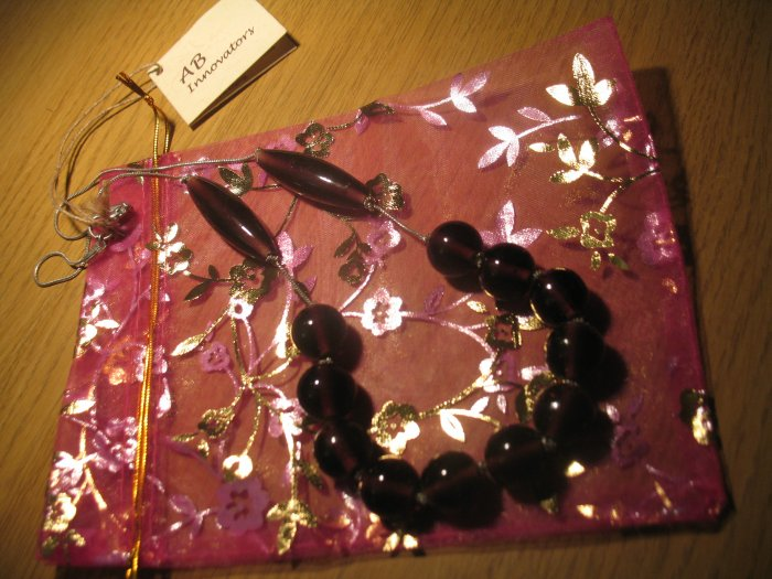 Purple glass beads on a silver tone chain