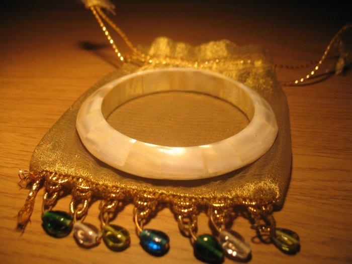 Triangle shell bangle