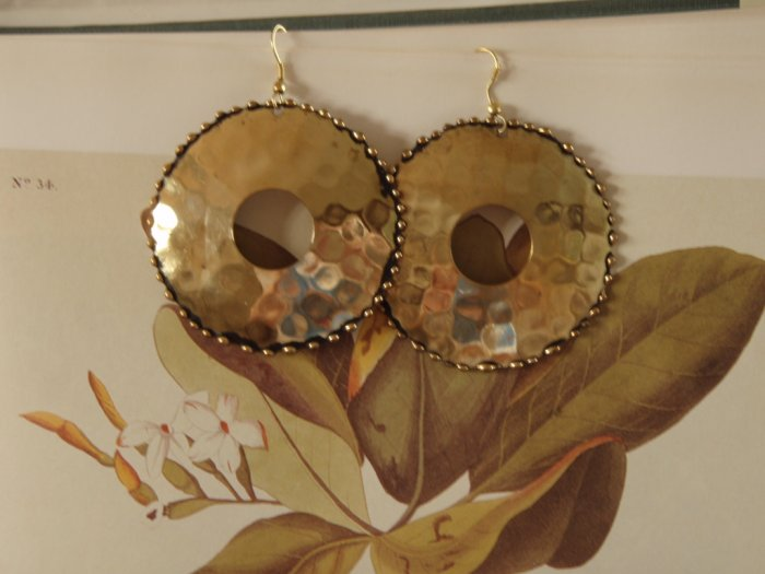 Gold tone dimpled disk earrings