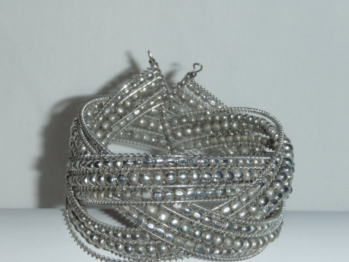 Silver tone intricately woven bead cuff