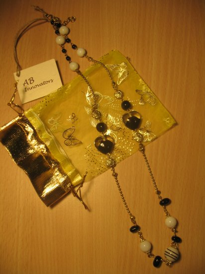 Black, white and gold glass, ceramic and metal bead necklace (£11.00)