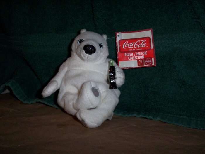 White Coca Cola Polar Bear with a Bottle of Coke