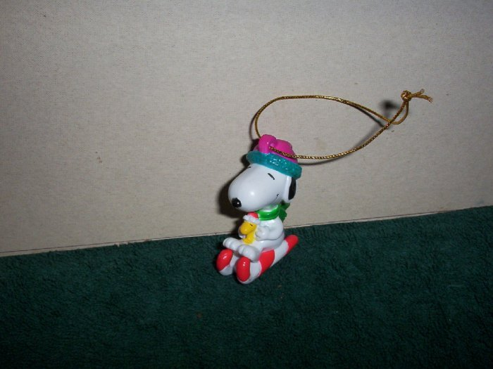 Snoopy on His Cane Cane Sled Ornament