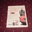 Champion Spark Plugs ad featuring Tom McCahill