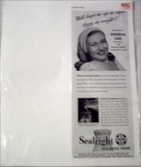 1948 Sealright Milk Bottle Hoods ad featuring Veronica Lake