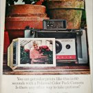 1965 Polaroid Land Automatic 104 Camera Woman and Flowers ad