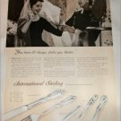 1957 International Sterling Silverware Change ad
