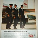 1963 TWA Airlines Meet the Team that Saves You Time ad