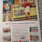 1959 GE Family Size Electric Rotisserie Oven ad