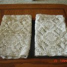 A pair of crochet place mat