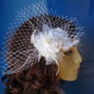 White feather fascinator with a diamond accent
