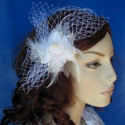 Ivory feather fascinator with a diamond accent
