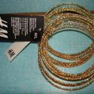 "H&M Pack of 15 shiny golden color Bracelet Bangle Med/Large 9.5"" circumference"