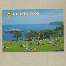 LLANDUDNO WALES LLANDUDNO PIER POSTCARD with FIRST CLASS STAMP AND POSTMARK
