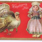 Thanksgiving Turkey Dutch Girl Smiling Vintage Gold Embossed Postcard