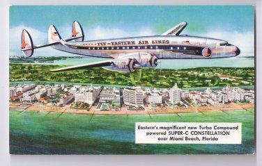 Eastern Air Lines Super-C Constellation Aircraft Over Miami Beach Aviation Postcard
