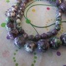 Purple, Green and White Ceramic Graduated Beads