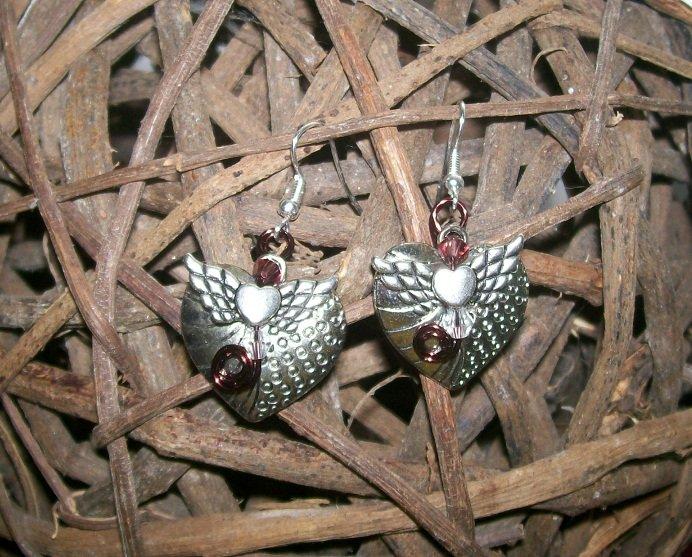 Heart shaped earrings with angel wings.