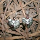 Heart shaped earrings with angel wings.