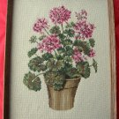 Large vintage pink Geranium needlepoint picture framed under glass