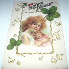 St. Patricks Day Green Shamrocks Antique Postcard-Red-haired Girl holding Dolly