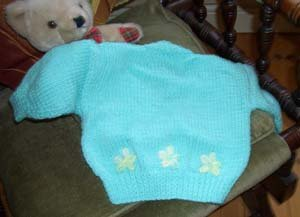 Newborn cardigan for a girl