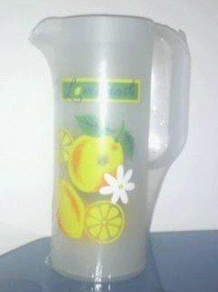 Plastic jug with plastic glasses inside
