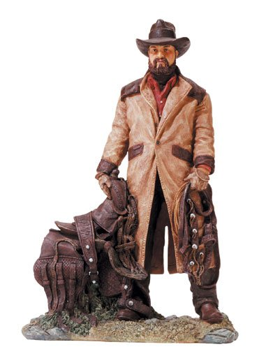 Cowboy With Saddle Figurine