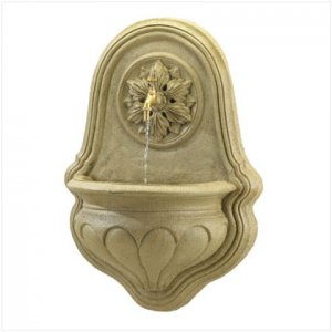 Wall Fountain With Floral Relief And Copper Tap