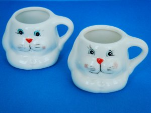 Two Small Ceramic Bunny Face Decorative Cups