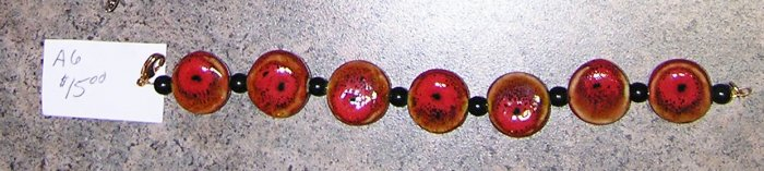 A6-Red Ceramic with Black Beaded Bracelet